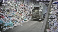 CS garbage truck driving away from conveyor belt video