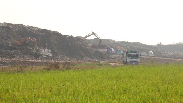 garbage truck moves trash time lapse in a landfill site, pollution, Global warming video