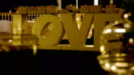 Garden decorated for a wedding party at night, big word Love in the center video