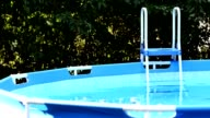 Garden swimming pool with stepladder. video