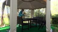 gardener man soak dap tulip flowers on arbor table in spring video
