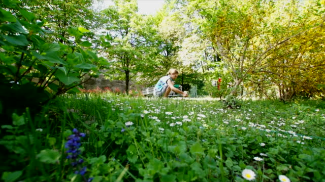 Gardener woman among her flowers and plants video