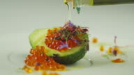 Garnish Red Salmon Caviar with Avocado and Olive Oil in Luxury Restaurant video