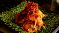Garnishing Nachos Salad video