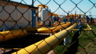 Gas and oil pipeline at the plant. Station for processing and storing natural gas. Transportation of raw materials, production of fuel. Pipes in the gas and oil fields. Tankers for storage video
