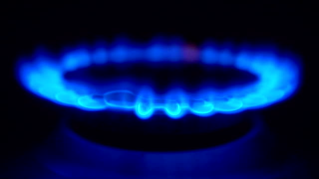 gas burning from a kitchen gas stove in slow motion video