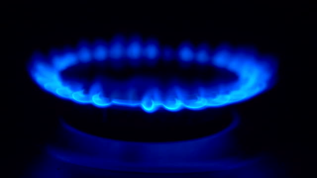gas burning from a kitchen gas stove with a match in slow motion video