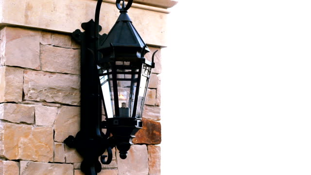 Gas burning lamp on the side of a wall video