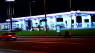 Gas station at night, contemporary petrol service cars drive in video