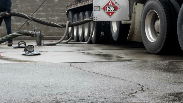 Gas station. Fuel truck driver pumping gasoline. video