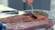 Gastronomic pleasure. A piece of meat with spices and oil video