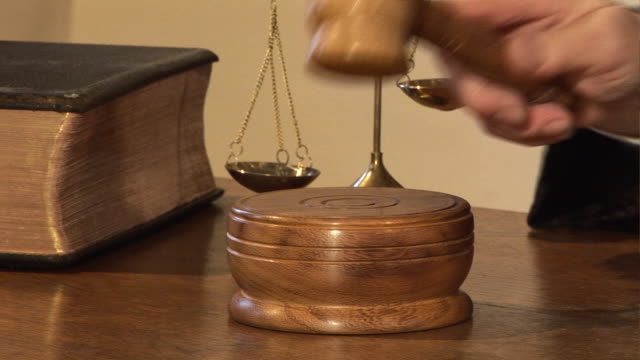 Gavel close up in Courtroom - Judge hits the block video