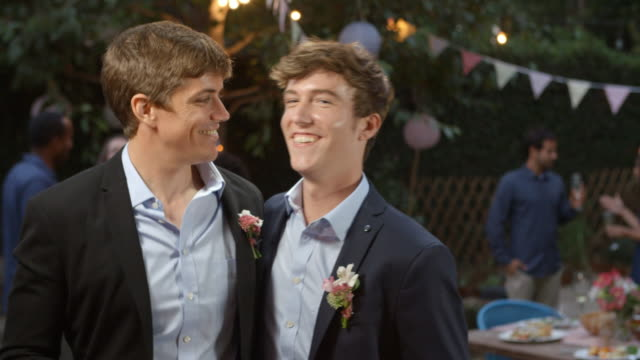 Gay Couple Celebrating Wedding With Party In Backyard video