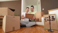 HD DOLLY: Gay Couple Decorating New Home video