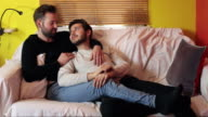 gay couple having a romantic chat on the couch video