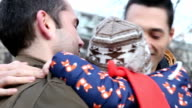 Gay couple with son outdoors video
