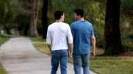 Gay Men Walk on Path Away From Camera CU video