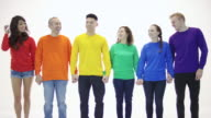 Gay pride group standing in unity holding hands in victory video