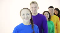 Gay pride group standing in unity wearing colored shirts video