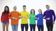 Gay pride group standing in unity with arms linked video