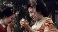 Geisha Maiko Together laughing OutdoorSlow Motion 4K video
