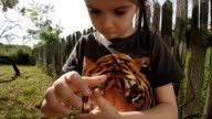 LEARNING PROCESS. Gender Neutral Child Playing With Insects. video