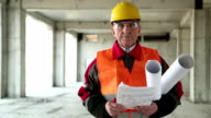 General foreman with building drawings at project site video