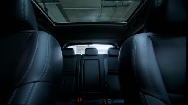 Generic empty car interior. Low angle track forward shot video