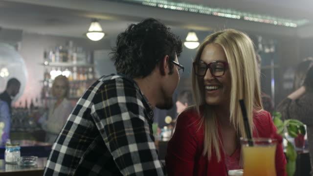 Gentleman seducing lady in cocktail bar video