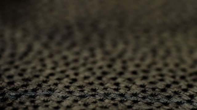 Genuine leather texture black color macro. video