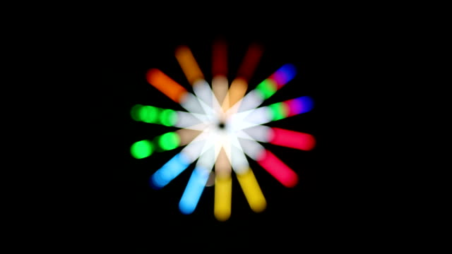 Geometric flower colorful lights spinning. video