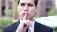 Gesture of Silence by Young Businessman video