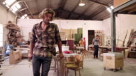 Getting down to work in his furniture studio video