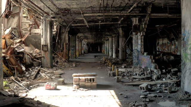 CLOSE UP: Ghostly ruined garage in deserted Fisher Body Plant auto factory, USA video