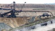 giant excavator digging on open coal mine video