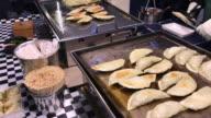 Giant fried Gyoza , Myeongdong street food , Seoul , South Korea. video