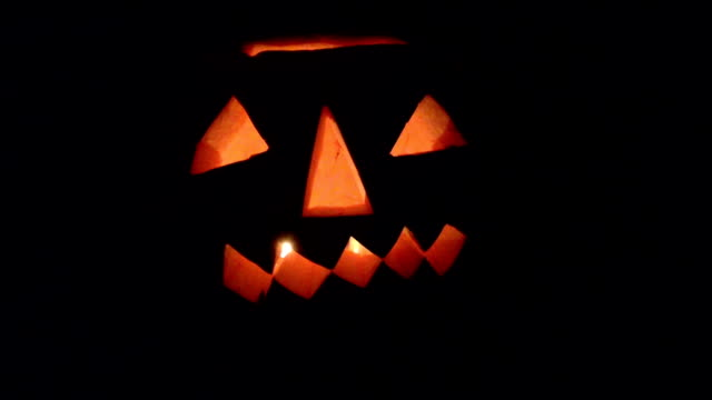 Giant Halloween Pumpkin Flickering At Night video