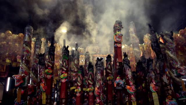 Giant incense sticks burning video