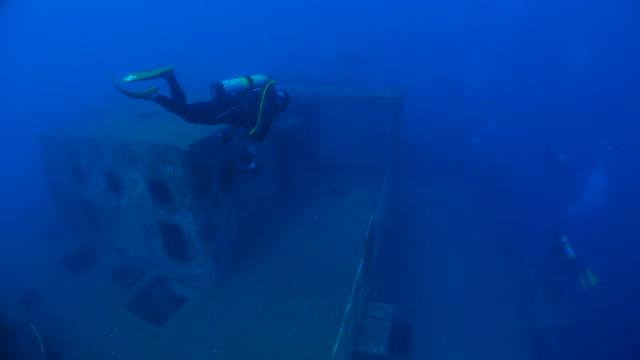 Giant shipwreck, diver, scuba diving video