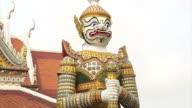 Giant statue around temple of dawn, wat Arun, landmark of Bangkok, Thailand video