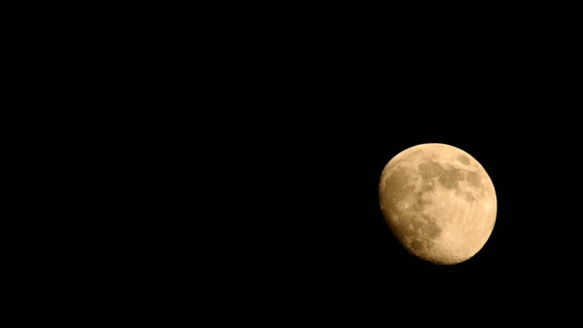 Gibbous moon rising up from entry to exit HD Video video