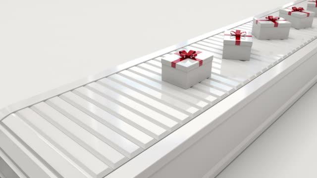 Gift boxes on conveyor belt video