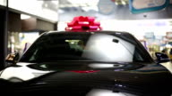 Gift expensive black car with red symbolic ribbon video