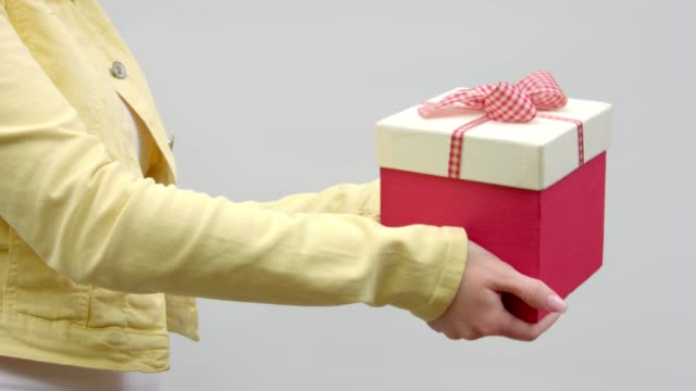 A gift in outstretched hands. video