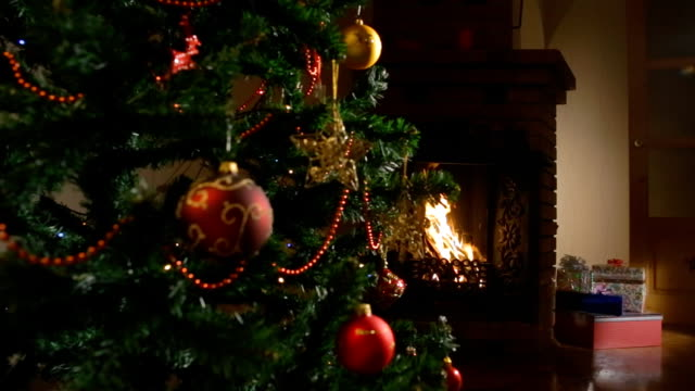 gifts under the Christmas tree, fireplace. background video