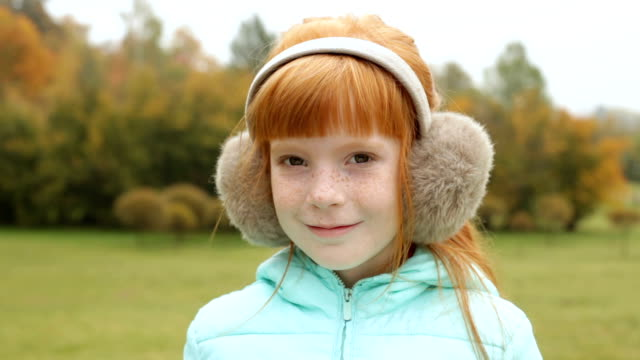 ginger girl in the earmuffs smiling video
