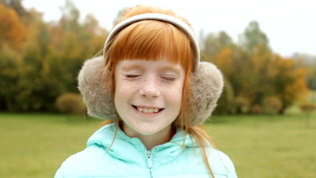 ginger girl in the earmuffs winking video