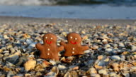 Gingerbread little men on the beach. video
