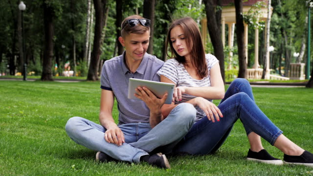 A Girl And a Guy Use a Digital Tablet video