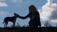 Girl and Dog on the Background of Sky video